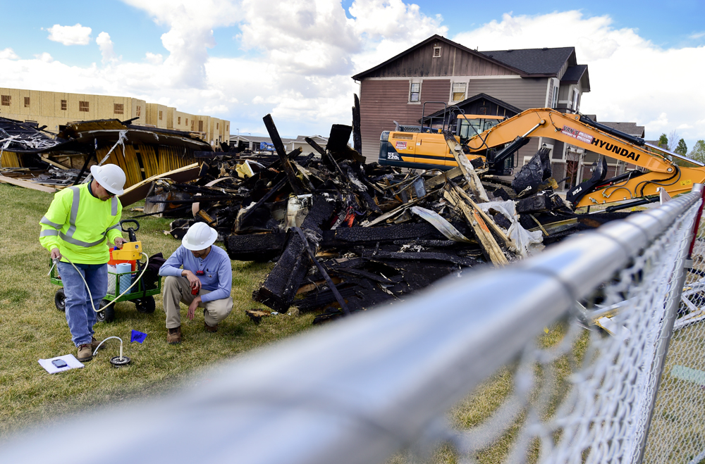 BEST1 Workers from the Colorado Oil and Gas Conservation Commission assist in the investigation on Friday into a fire that killed two people and injured two others in Firestone. Matthew Jonas/Staff Photographer April 28,  2017