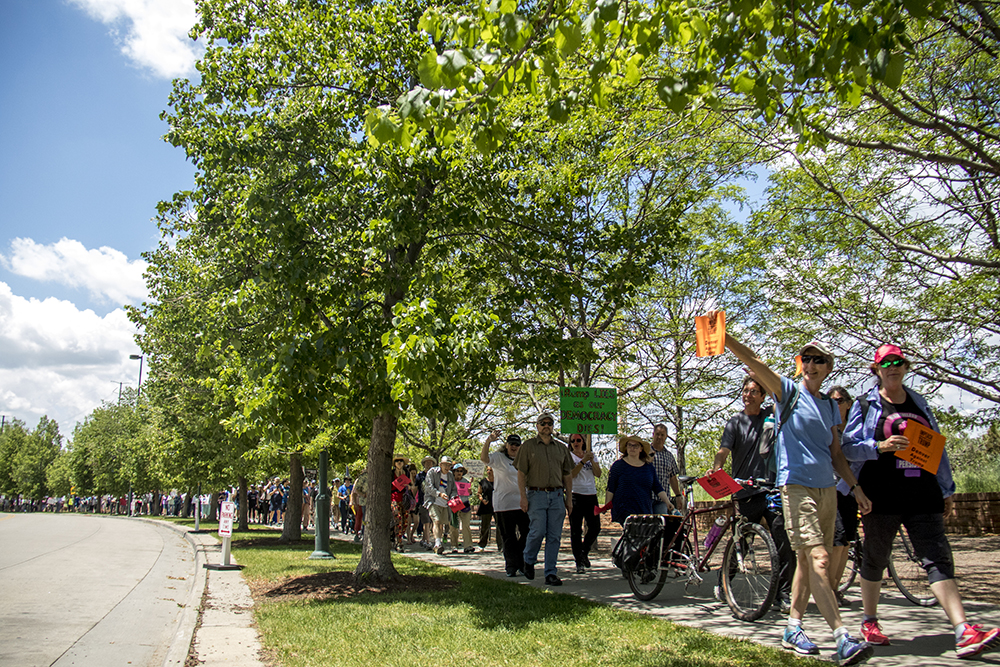Protesters march out of Commons Park after speeches were made there, the March for Truth, June 3, 2017. (Kevin J. Beaty/Denverite)  protest; march for truth; kevinjbeaty; denver; colorado; denverite; commons park;