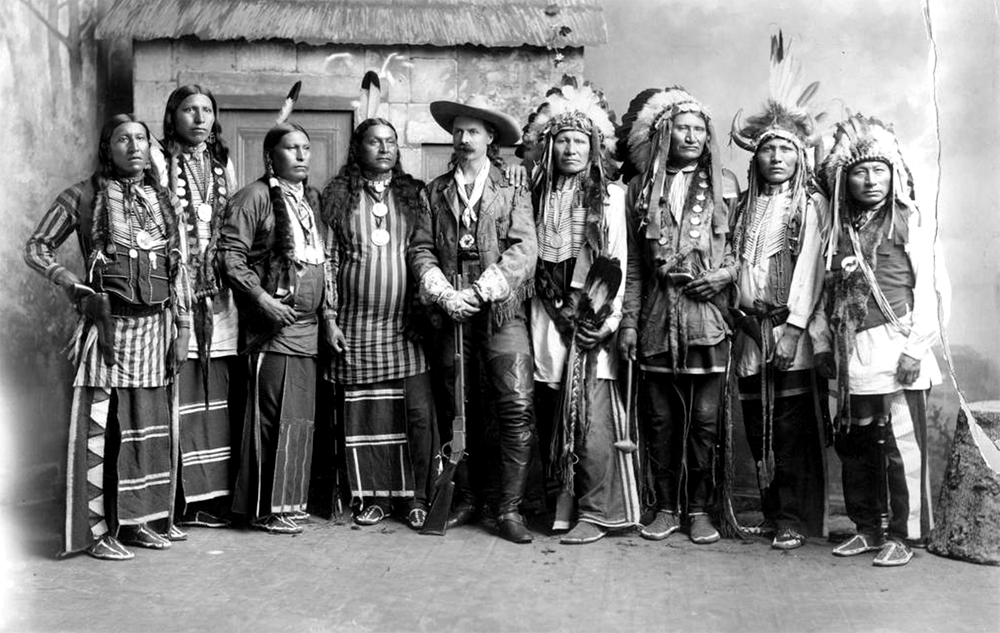 "William Frederick ""Buffalo Bill"" Cody stands in the left center of a group of Native American chiefs. The group includes, from left, Brave Chief, Eagle Chief, Knife Chief, Young Chief, Buffalo Bill, American Horse, Rocky Bear, Flys Above and Long Wolf. (Denver Public Library/Western History Collection/NS-132)  denver public library; buffalo bill; wild west; colorado;"