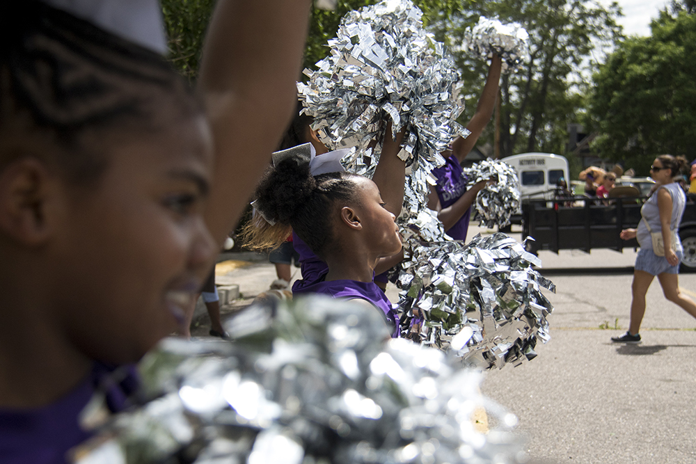 Kam'ryn dances in a line of fluttering pom poms. The Juneteenth parade in Five Points, June 17, 2017. (Kevin J. Beaty/Denverite)  juneteenth; five points; black history; kevinjbeaty; denver; colorado; denverite; street fair; festival; welton street;