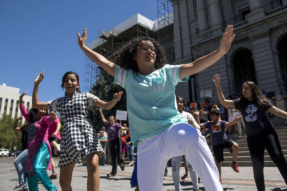 Bhawana Paudl danes in the In Tandem Flash Mob of Empathy. World Refugee Day, June 20, 2017. (Kevin J. Beaty/Denverite)  denver; denverite; world refugee day; colorado; kevinjbeaty; capitol hill; rally;