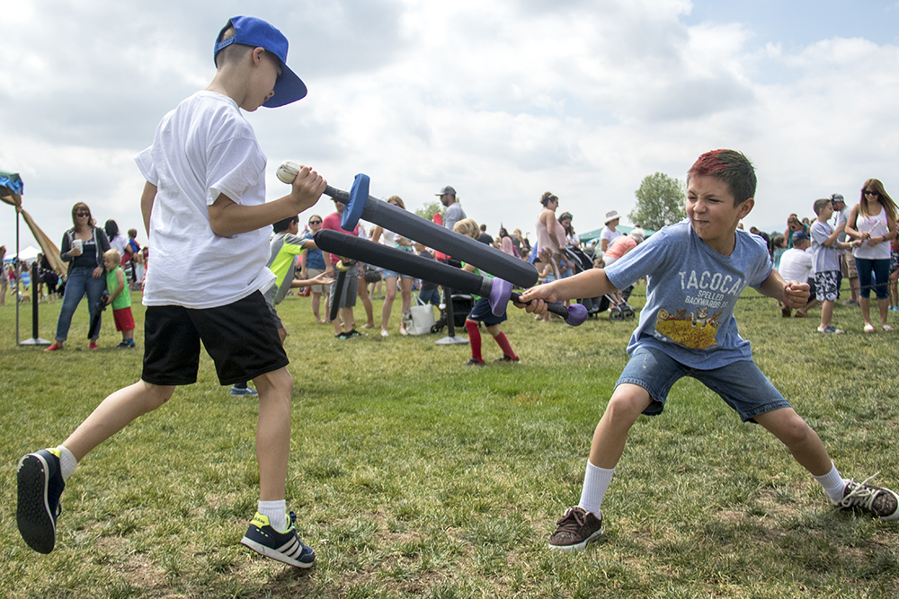 Aiden (left) and Soren battle in the sword ring. The first-annual Unicorn Festival in Clement Park, Littleton. (Kevin J. Beaty/Denverite)