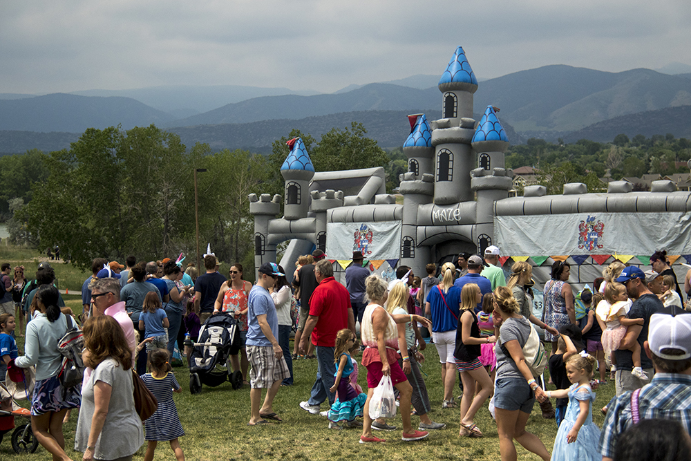A castle was inflated on the horizon. The first-annual Unicorn Festival in Clement Park, Littleton. (Kevin J. Beaty/Denverite)