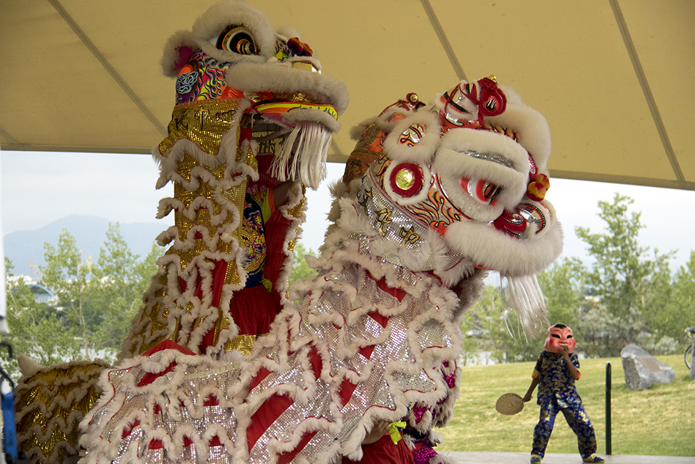 The Colorado Asian Culltural Heritage Center performs. The first-annual Unicorn Festival in Clement Park, Littleton. (Kevin J. Beaty/Denverite)  colorado; kevinjbeaty; unicorn festival; denverite; littleton; whimsy; summer;