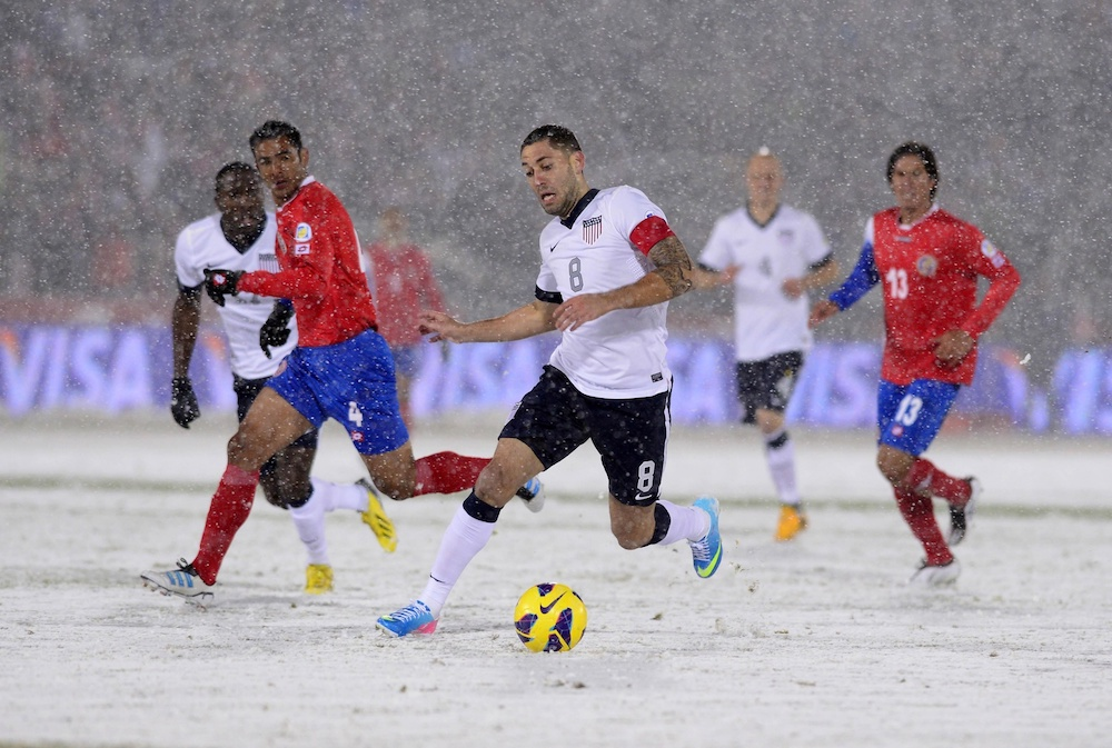 Clint Dempsey dribbles the ball in some snowy conditions against Costa Rica. (Ron Chenoy/USA Today Sports)