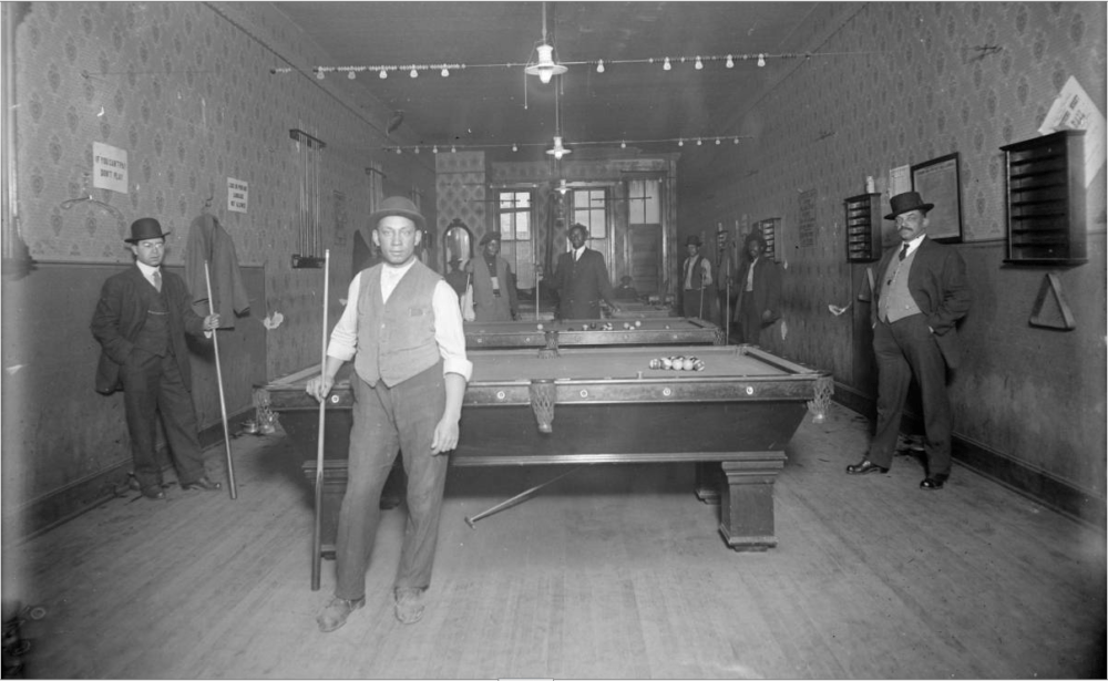 Men pose in a billiards hall in Denver circa 1910. (History Colorado/William W. Cecil Collection/Denver Public Library)