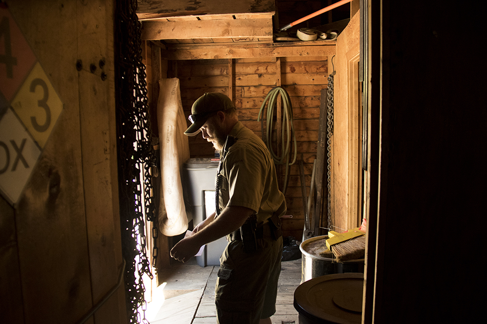 Park Ranger Ryan Phillian inside an old CCC cabin. Red Rocks, July 11, 2017. (Kevin J. Beaty/Denverite)  red rocks; Civilian Conservation Corps; history; kevinjbeaty; morrison; colorado; denverite;
