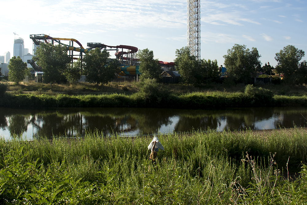 A woman leaves an illicit campsite in the morning along South Platte River. (Kevin J. Beaty/Denverite)  south platte river; environment; ecology; denver; denverite; kevinjbeaty;