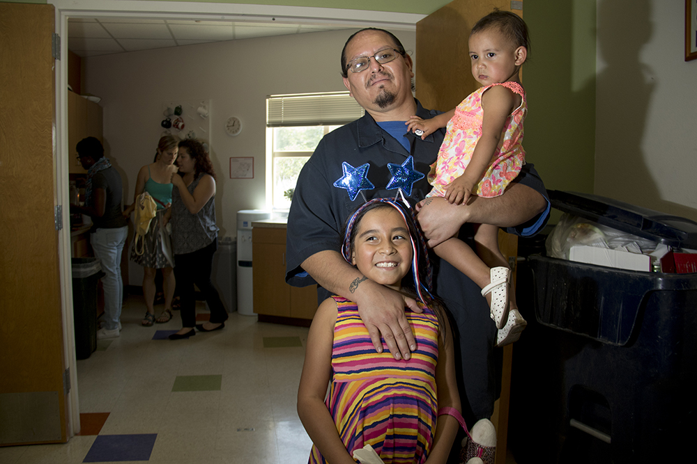 Rey G. and his daughters Ana and Sara. Members of the Globeville, Elyria-Swansea Coalition for Health and Housing Justice call for the creation of a community land trust, July 18, 2017. (Kevin J. Beaty/Denverite)  denver; denverite; kevinjbeaty; colorado; elyria swansea; globeville; focus points; gentrification;