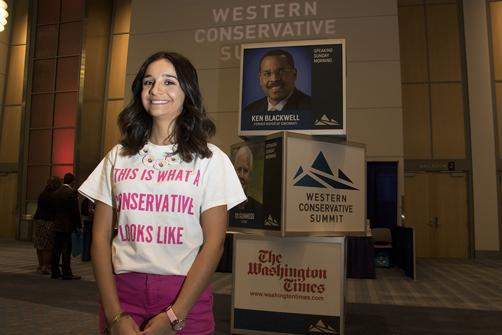 Vanessa Rivera at the Western Conservative Summit, July 21, 2017. (Kevin J. Beaty/Denverite)  western conservative summit; wcs; protest; cory gardner; healthcare; adapt; medicaid; denver; denverite; kevinjbeaty;