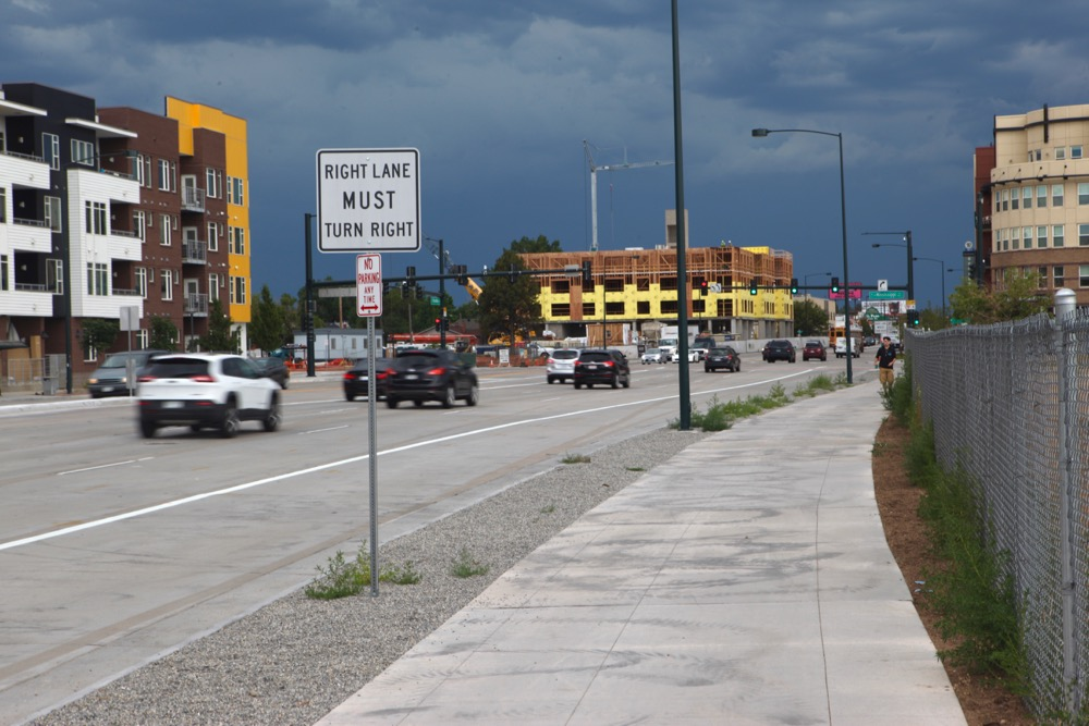 Wider sidewalks on South Broadway. Doom clouds not included. (Andrew Kenney/Denverite)