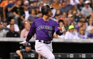 Carlos Gonzalez broke out Tuesday night with two run-scoring hits. (Ron Chenoy/USA Today Sports)