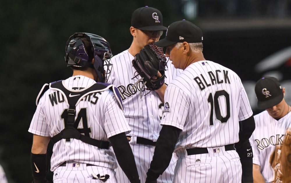 Colorado Rockies manager Bud Black (10) talks to catcher Tony Wolters (14) and starting pitcher Jeff Hoffman (34) in the first inning against the Pittsburgh Pirates at Coors Field. Jul 21, 2017. (Ron Chenoy/USA TODAY Sports)