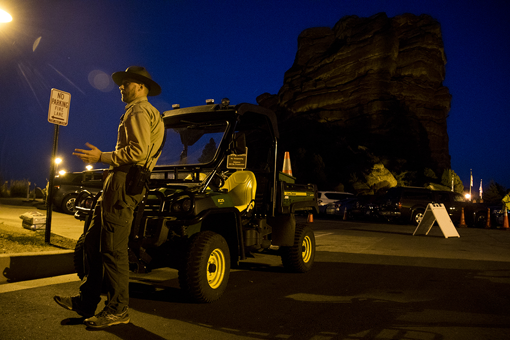 Park rangers stand outside of Red Rocks Amphitheatre during a Darius Rucker concert, Aug. 1, 2017. (Kevin J. Beaty/Denverite)  denverite; kevinjbeaty; morrison; colorado; red rocks;