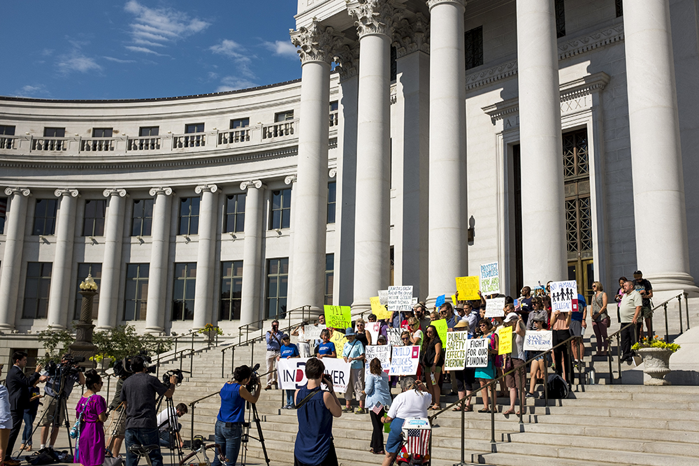 A rally on the steps of the City and Couny Building before a Denver City Council hearing on immigration policy begins, Aug. 2, 2017. (Kevin J. Beaty/Denverite)immigration; undocumented; city and council building; denver; colorado; denverite; city council; kevinjbeaty;