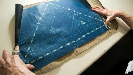 The Brown Palace Hotel's historian Debra Faulkner displays original blueprints inside the hotel's archive, Aug. 4, 2017. (Kevin J. Beaty/Denverite)  brown palace hotel; denver; colorado; denverite; kevinjbeaty;