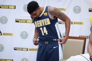 Gary Harris models the new jersey. (Austin Cope/For Denverite)