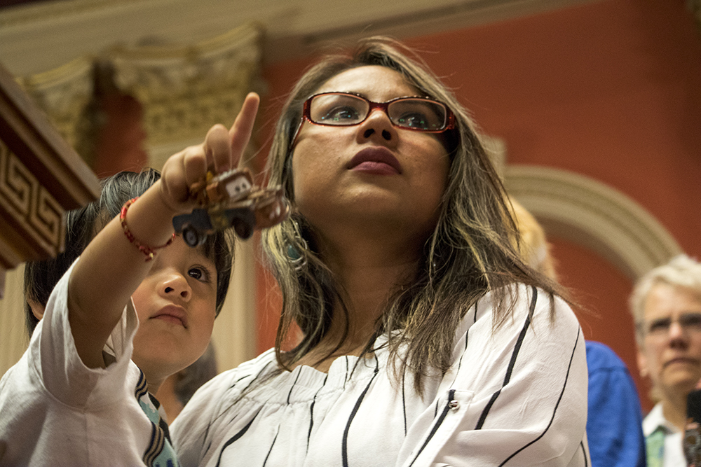 Ingrid Encalada Latorre holds her son, Anibal, during a press conference announcing that a judge has denied her the chance to re-try a felony charge, Aug. 31, 2017. (Kevin J. Beaty/Denverite)