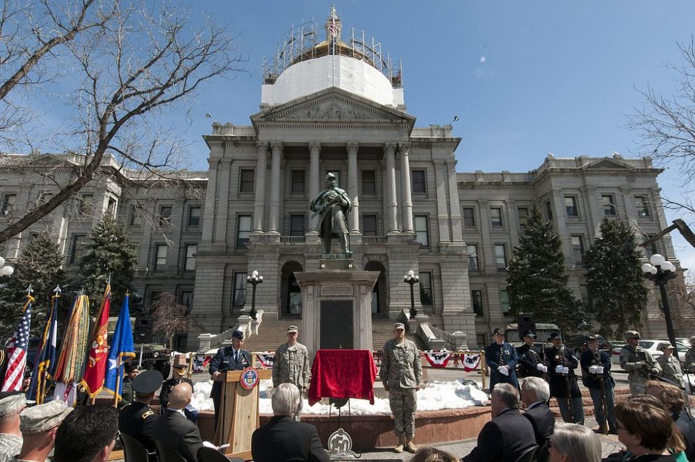 """A statue of a Union soldier near the Colorado State Capitol once praised the """"Battle of Sand Creek."""" In fact, it was a massacre. (Wolfram Stumpf/Wikimedia Commons)  capitol building; gold dome;"""