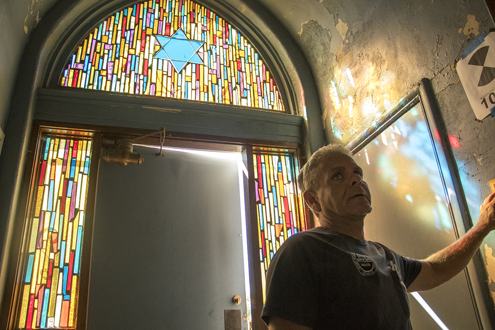 RMCAD groundskeeper Regan Headrick inside the old synagogue, which is his charge to maintain. A synagogue in Lakewood that was once used by the Jewish Consumptive Relief Society. It was re-constructed in 1925 and now sits on the campus of the Rocky Mountain College of Art and Design. Sept. 18, 2017. (Kevin J. Beaty/Denverite)  denver; colorado; denverite; kevinjbeaty; rmcad; lakewood; west colfax; jcrs; judaism; synagogue;