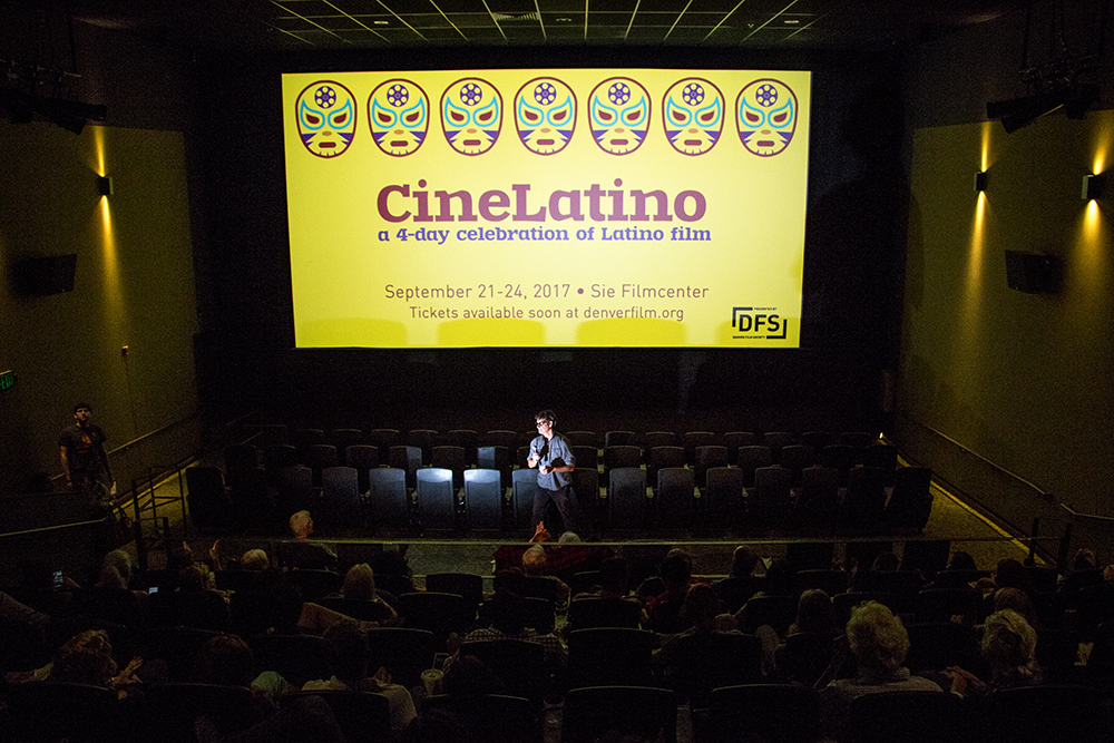 Denver Film Society artistic director Brit Withey opens the first night of CineLatino at the Sie Film Center, Sept. 21, 2017. (Kevin J. Beaty/Denverite)