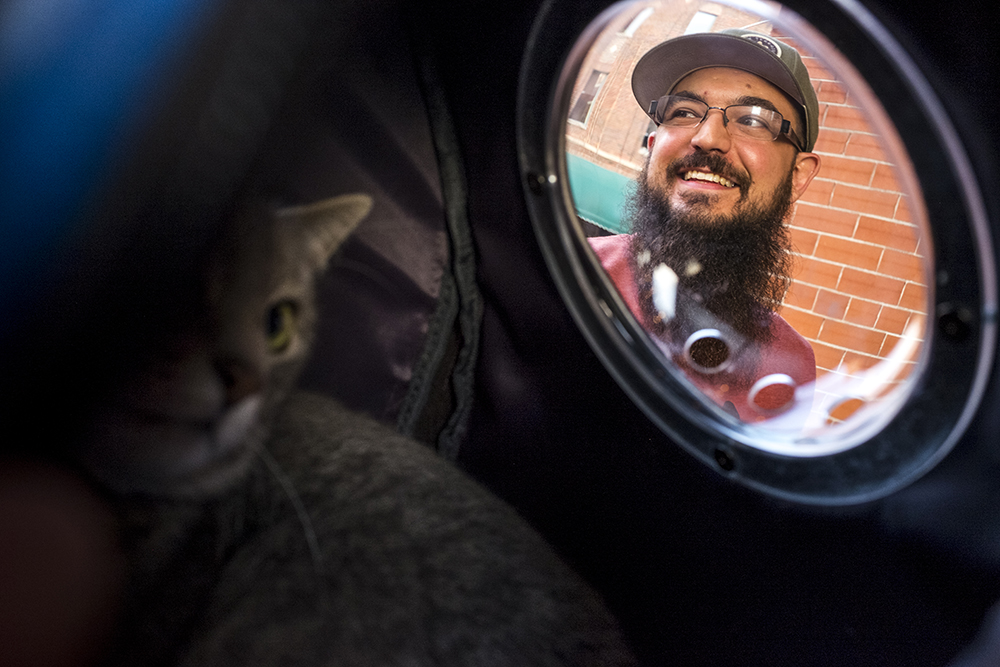 Elaia the brewery cat visits Wynkoop brewery with her owner, Michael Roberts, Aug. 30, 2017. (Kevin J. Beaty/Denverite)   beer; brewery; denver; colorado; brewery cat; pets; animals; nightlife; denverite; kevinjbeaty;
