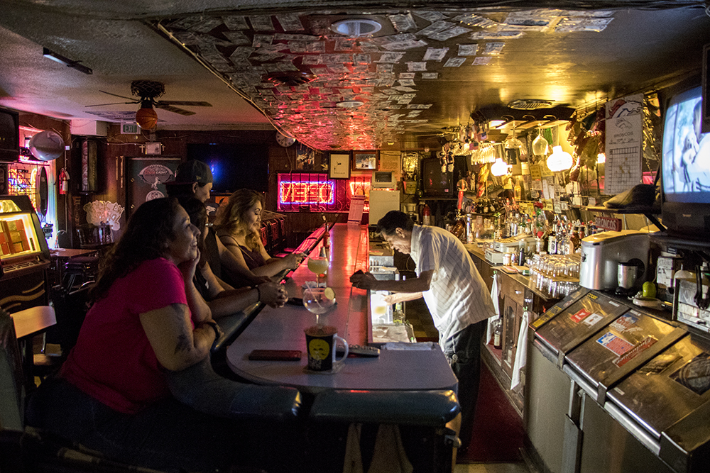 Regina Romero (left to right), Nancy Vallejo, Rocio Estrada and Elena Hernandez sit at the bar in their long-time northside hangout, Zitro CityView Tavern on Navajo Street, Sept. 5, 2017. (Kevin J. Beaty/Denverite)  north side; highland; bar; nightlife; kevinjbeaty; denverite; colorado; denver;