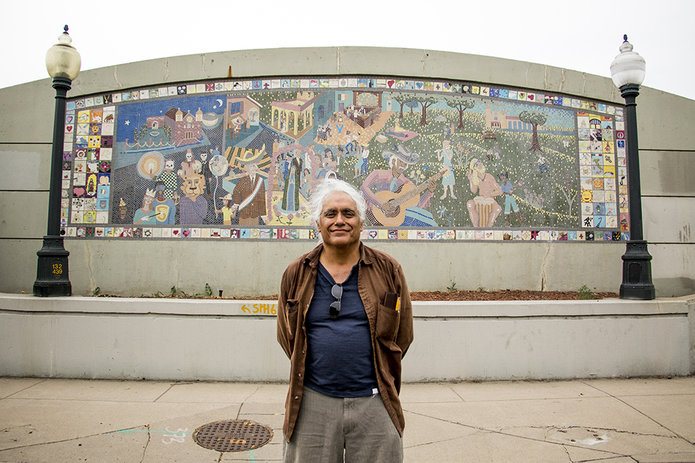 "Artist Bob Luna stands in front of ""Celebrations of the Neighborhood,"" a mosiac that he and and Martha Keating installed on Kalamath Street in 1993, Sept. 11, 2017. (Kevin J. Beaty/Denverite)  kevinjbeaty; denver; denverite; colorado; highland; mural; public art;"