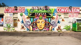A mural on the side of Sportsmans Liquor in Villa Park, Sept. 11, 2017. (Kevin J. Beaty/Denverite)