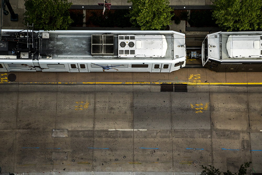 An RTD train seen from atop the Le Meridien Hotel on California Street downtown. (Kevin J. Beaty/Denverite)