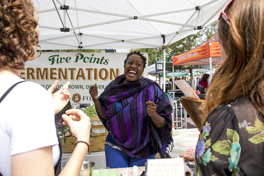 Asia Dorsey at her Five Points Fermentation booth set up at the Union Station farmers market, Sept. 16, 2017. (Kevin J. Beaty/Denverite)  food; union station; farmers market; gentrification; kevinjbeaty; denverite; colorado; denver;