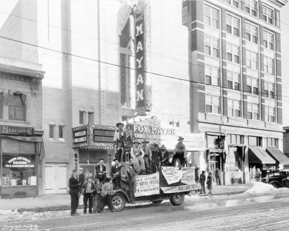 Men pose in November 1930 on a truck near the Mayan Theatre at 110 Broadway in the Speer neighborhood of Denver. (Rocky Mountain Photo Co./Denver Public Library/X-24681)