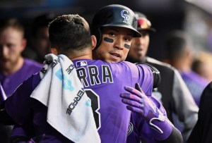 Gerardo Parra and Carlos Gonzalez hug it out. (Ron Chenoy/USA Today Sports)