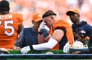 Garett Bolles was carted off the field Sunday. (Ron Chenoy/USA Today Sports)