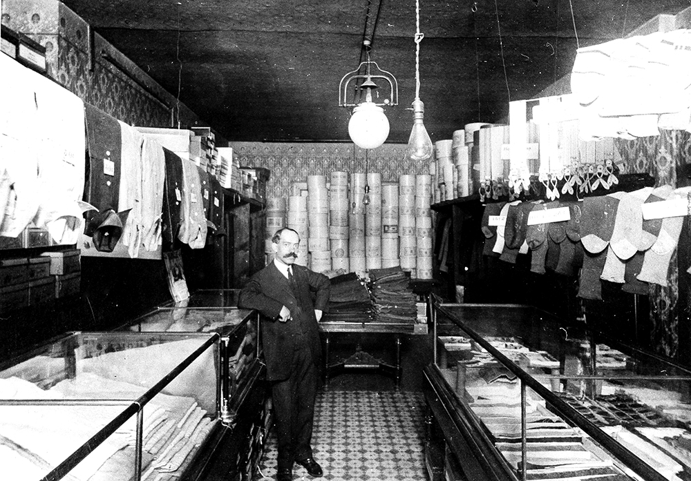 Abraham Grossman appears here in his store, the Grossman's Haberdashery, in Denver around 1920. (Courtesy: Beck Archives special collection/University of Denver)  jewish; history; archival; denver;