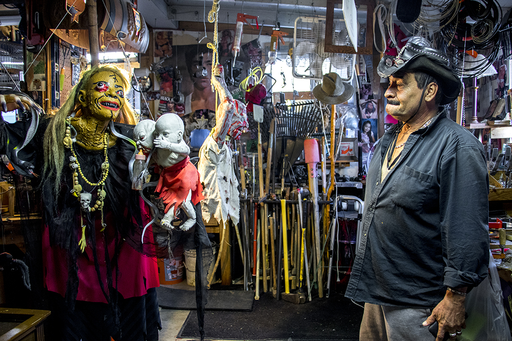 "Johnny ""the Puppetmaster"" Sandoval (right) and ""my momma"" in his man cave behind his Mar Lee home. Oct. 24, 2017. (Kevin J. Beaty/Denverite)  denver; colorado; denverite; kevinjbeaty; mar lee; halloween; odd spots; haunted house;"