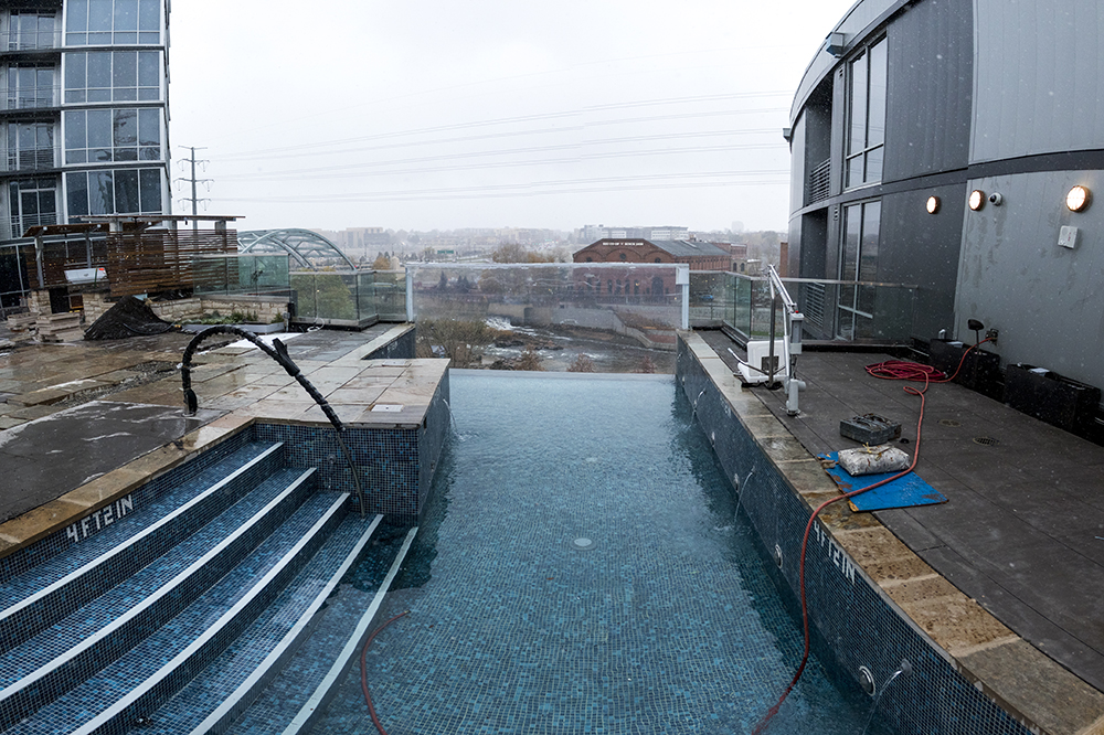 The wall of this pool facing Confluence Park is transparent, Oct. 26, 2017. (Kevin J. Beaty/Denverite)  denver; colorado; denverite; kevinjbeaty; the confluence; development; residential real estate; high density housing; skyscraper;