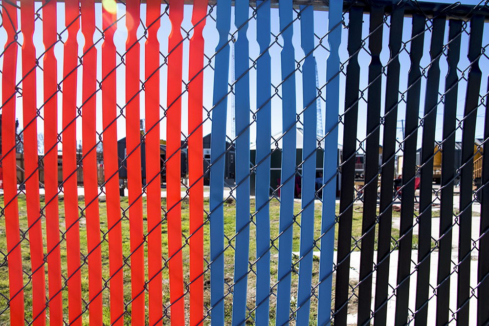 The Beloved Community Tiny Home Village gets some vibrant art on their fence, Oct. 29, 2017. (Kevin J. Beaty/Denverite)