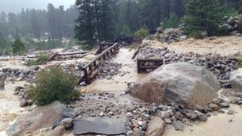Alluvial Fan Bridge is overwhelmed by floodwaters during the Sept. 12, 2013 floods. (Courtesy Rocky Mountain National Park)