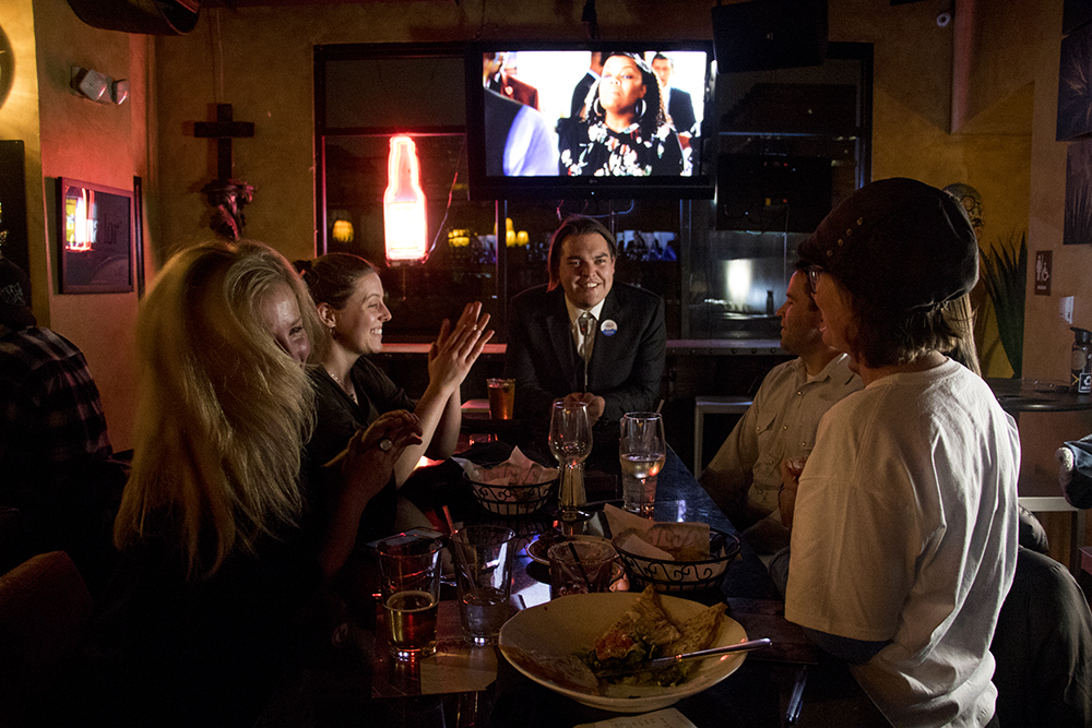 Ean Tafoya hangs at the end of a table during a party awaiting the election results of the green roof initiative, Nov. 7, 2017. (Kevin J. Beaty/Denverite)  green roof initiative; election; denver; denverite; colorado; kevinjbeaty;