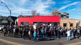 The protest spilled into the street. A rally against Ink! Coffee in Five Points, Nov. 25, 2017. (Kevin J. Beaty/Denverite)  kevinjbeaty; denver; denverite; colorado; ink coffee; five points; rino; gentrification; protest;