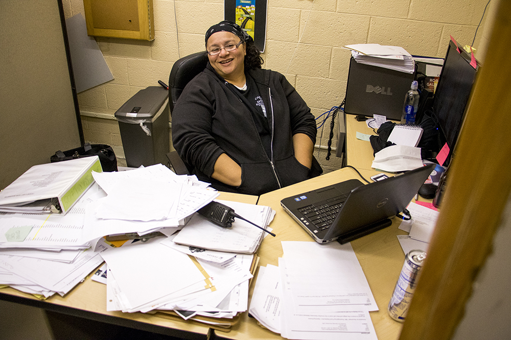 LJ Harker in her office sometime after 1 a.m. The Epworth Foundation's annual Feed a Family Thanksgiving dinner giveaway, Nov. 18, 2017. (Kevin J. Beaty/Denverite)  denver; colorado; denverite; kevinjbeaty; cole; thanksgiving; food pantry; food insecurity;