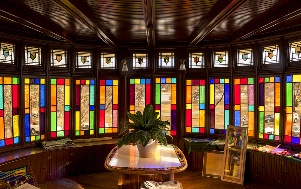 """The stained-glass-lined """"wheel room"""" atop Gary L. Johnson's """"rainbow house,"""" across the street from Washington Park. (Kevin J. Beaty/Denverite)  denver; colorado; denverite; kevinjbeaty; washington park west; stained glass; residential real estate; collector;"""