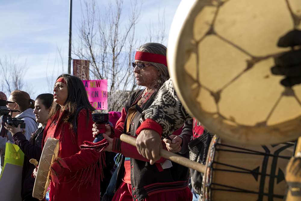 Laura Maranjo walks with burning incense at the front of the 2018 Women's March, Jan. 20, 2018. (Kevin J. Beaty/Denverite)  protest; rally; copolitics; denver; colorado; denverite; kevinjbeaty;