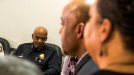 Former Denver Police Chief Robert White listens to Mayor Michael Hancock. (Kevin J. Beaty/Denverite)