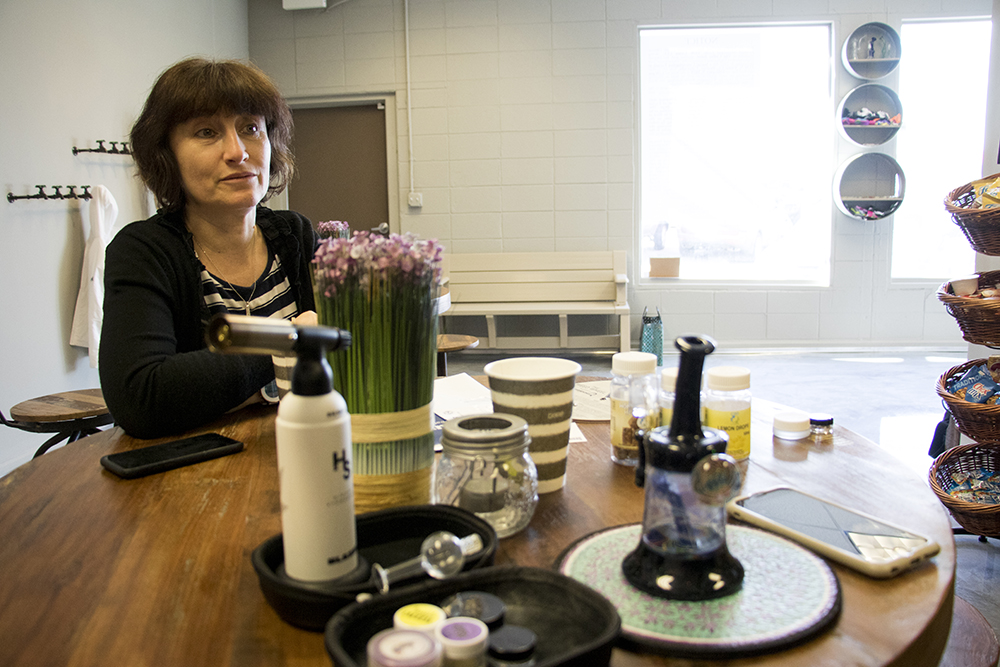 The Coffee Joint owner Rita Tsalyuk sits in the middle of her shop next to I-25 in Lincoln Park, Feb. 6, 2018. (Kevin J. Beaty/Denverite)  lincoln park; denver; colorado; denverite; kevinjbeaty; social consumption; marijuana; coffee shop;