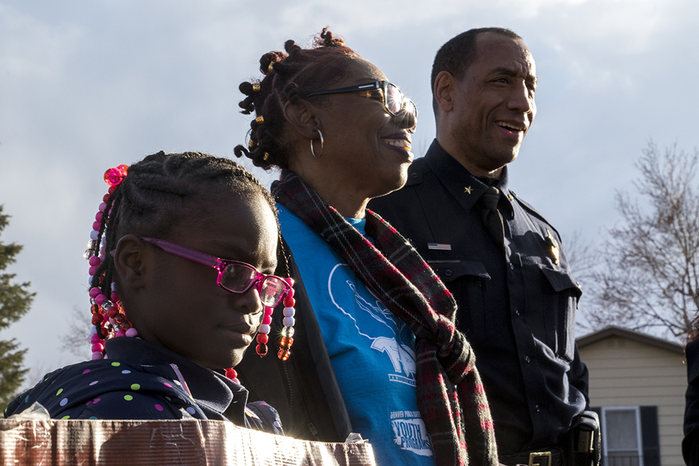 8-year-old Dae'Aunna (left to right), Kiera Jackson and District 5 Commander Ron Thomas at a rally to end violence in Montbello after a rash of murders in the area. Feb. 6, 2018. (Kevin J. Beaty/Denverite)  montbello; crime; gun violence; denver; denverite; kevinjbeaty; colorado;