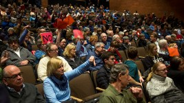 The crowd reacts as Mike Coffman speaks at a town hall event at Cherry Creek High School, Feb. 21, 2018. (Kevin J. Beaty/Denverite)  copolitics; town hall; mike coffman; greenwood village; denver; colorado; denverite; kevinjbeaty;