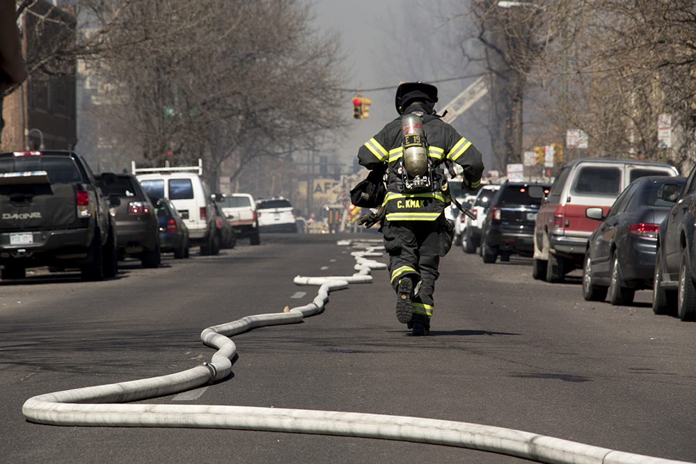 A huge fire is put out near the intersection of 18th Avenue and Emerson Street, March 7, 2018. (Kevin J. Beaty/Denverite)