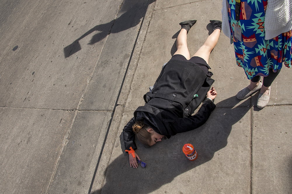 "Lee Kucic on the ground during a ""die-in"" in protest against gun violence, Mach 14, 2018. (Kevin J. Beaty/Denverite)  protest; rally; denver; valverde; denverite; kevinjbeaty; colorado;"